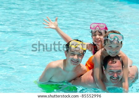 Family in pool - stock photo