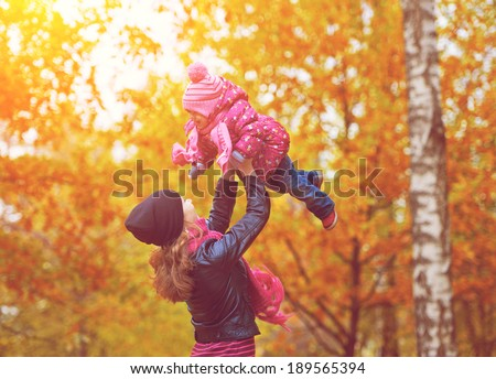 ��½��°��?��?��? family. Mom and baby daughter for a walk in the autumn - stock photo