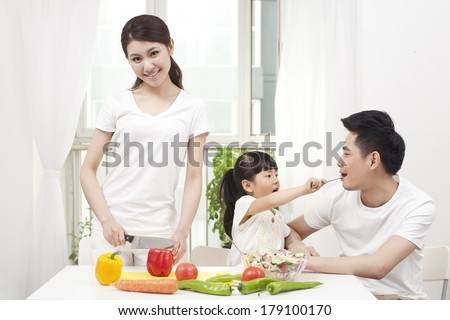 Family preparing a salad
