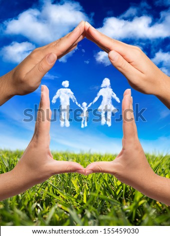 family symbol in home: hands and clouds in nature  - stock photo