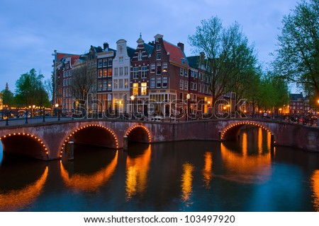famous canals of Amsterdam, the Netherlands at duskmous canals of Amsterdam, the Netherlands at dusk - stock photo