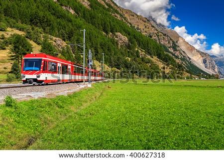 Famous electric red tourist train in Zermatt,Valais region,Switzerland,Europe - stock photo