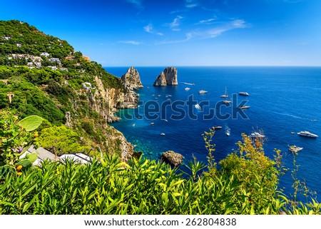 Faraglioni cliffs panorama,and the stunning Tyrrhenian sea,Capri island,Campania,Italy,Europe - stock photo