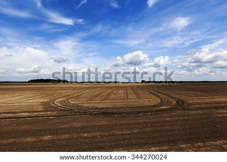 farm field ready for planting crops. arable land. blue sky