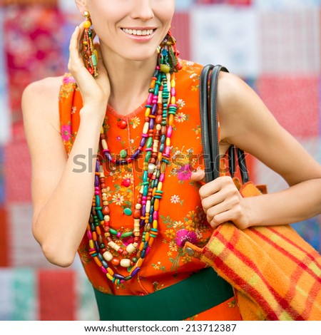 Fashion stylish woman. Portrait of elegant woman with bright accessories over patchwork handmade background. focus on lips