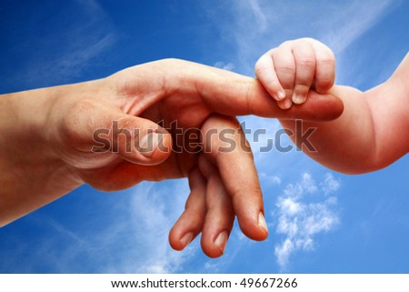 Father's and baby's hands - stock photo