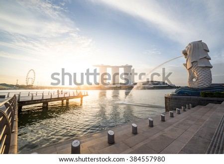 28 FEB 2016 , SINGAPORE- The Merlion fountain and Singapore skyline on . Merlion is an imaginary creature with a head of a lion and the body of a fish and is often seen as a symbol of Singapore. - stock photo