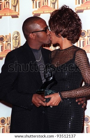 27FEB98:  Singer WHITNEY HOUSTON & husband BOBBY BROWN at the Soul Train Awards where she was presented with the 1998 Quincy Jones Award for Career Achievement. - stock photo