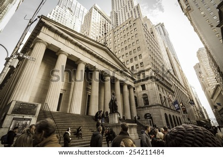 [2013-12-28] Federal Hall National Memorial, Wall street, Manhattan, New York, which was built in 1842. The hall, George Washington statue, NYC skyscrapers and tourist are visible in the photo. - stock photo