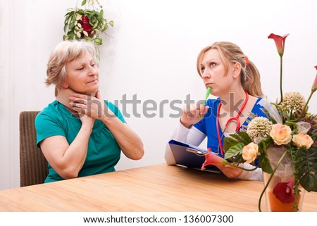 female doctor and Senior with ruff - stock photo