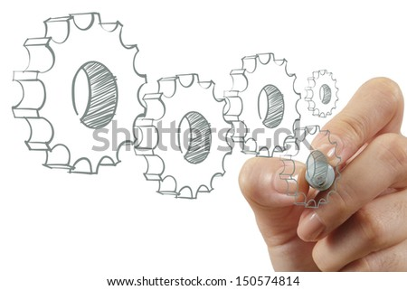 female hand draws gear to success as concept - stock photo