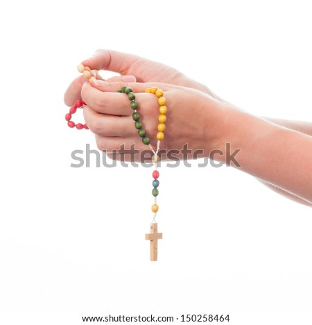 female hands holding rosary - isolated on white background - stock photo