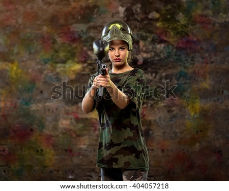 Female paintball player with dangerous look  - stock photo