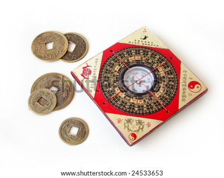 Feng shui compass (Luopan) and chinese coins on white background