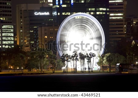 ferris wheel in the business district - stock photo