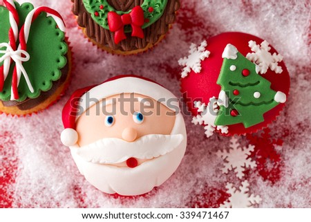 festive Christmas mini desserts over snowy background