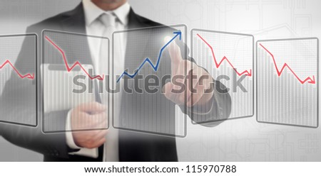 Finger pushing sensitive graphic on a touch screen interface - stock photo