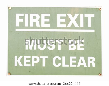 Fire exit sign with white text over green vintage - stock photo