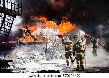 Firemen extinguishing