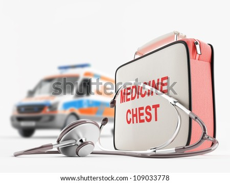First aid kit and stethoscope against ambulance - stock photo