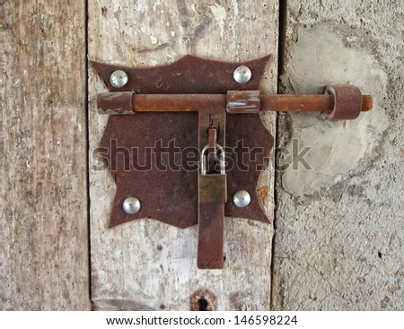 first plane of an iron bolt in a wooden door                                - stock photo