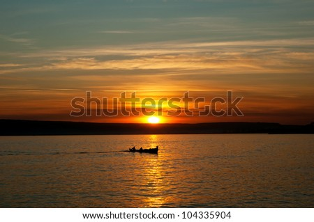 fishing boat at lake sunset