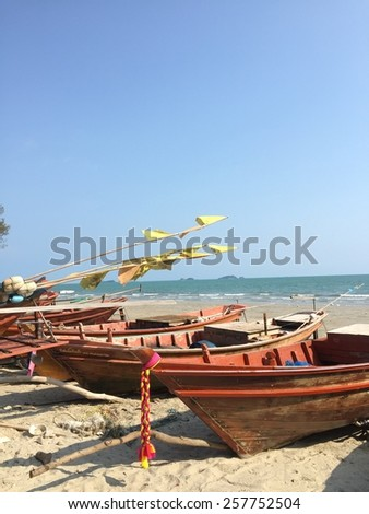 Fishing boat on the beach of Thailand - stock photo