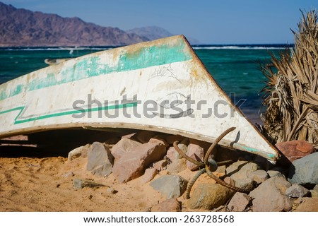 Fishing boat on the reef during the storm. Red Sea. Dahab.Egypt. - stock photo
