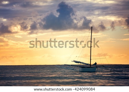 fishing boat sailing alone at sea over beautiful sky