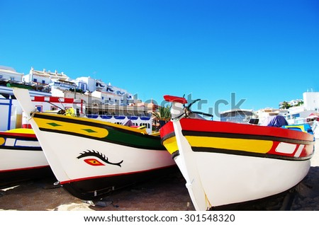 fishing boats on the beach, Algarve, Portugal - stock photo