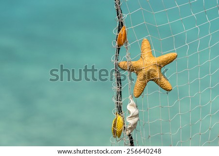 fishing net  on a tropical beach background - stock photo