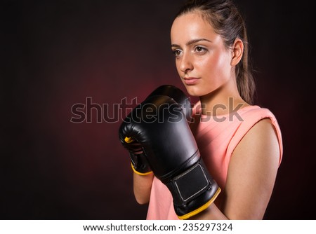 Fitness girl training kick boxing