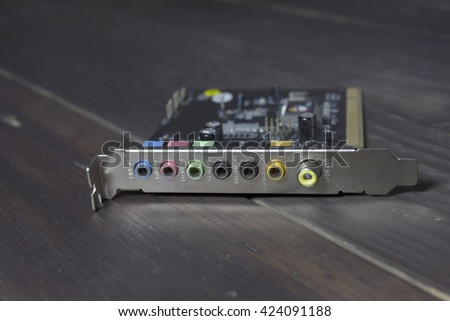 fixes motherboard in service center. Shallow DOF, focus on hands, image is toned with extra light effects - stock photo