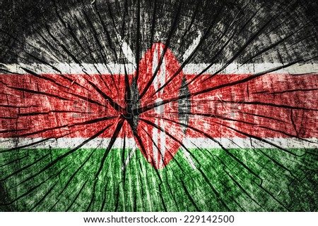 flag of Kenya on cracked wooden texture - stock photo