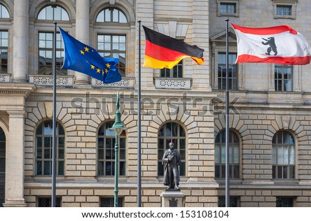 3 flags (Europe, Germany, Berlin) infront of Abgeordnetenhaus of Berlin, the state parliament (Landtag) for the German state of Berlin, Germany - stock photo