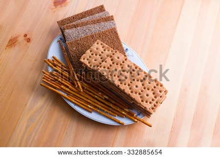flat and dry type of bread and cracker containing mostly rye flour. - stock photo