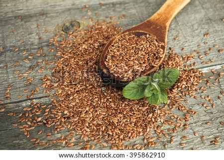Flax seed  and mint on a wooden background - stock photo