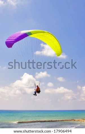 Flight on an operated parachute along coast of Mediterranean sea