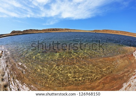 Flood of the artificial lake Powell photographed Fisheye lens.  Turquoise water in the red desert - stock photo