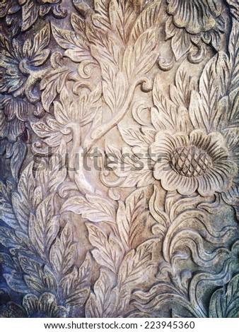 flora background engrave on a woodden board - stock photo