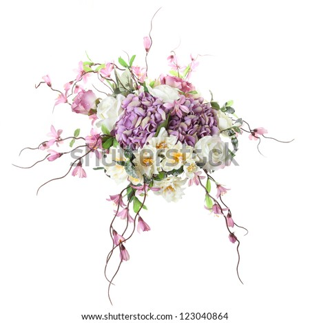 floral arrangement of artificial flowers on a white background - stock photo