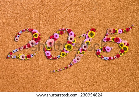 Flowers on festive on Fragment of modern rough stucco Background - stock photo
