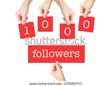 1000 followers written on cards held by hands