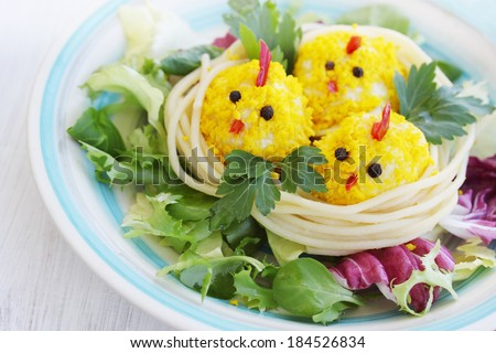 Food for the baby, the little chicks in the nest - stock photo