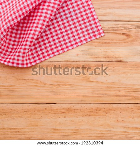 For recording menu, recipe on red checkered tablecloth tartan on wooden kitchen table close up view from top - stock photo