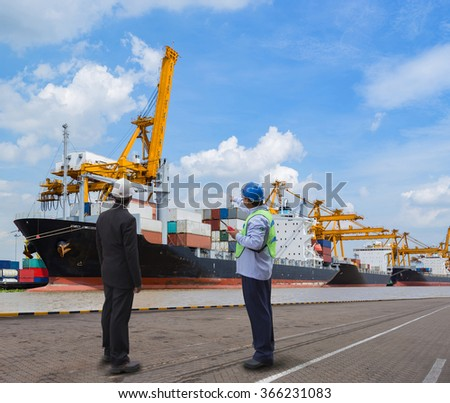 foreman control Industrial Container Cargo freight ship from his manager with working crane bridge in shipyard with truck