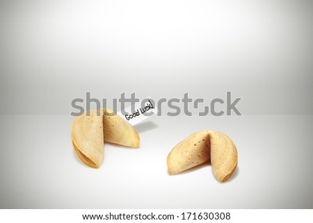 2 fortune cookies with good luck tag