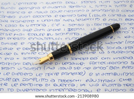 fountain pen on a sheet written by hand  - stock photo