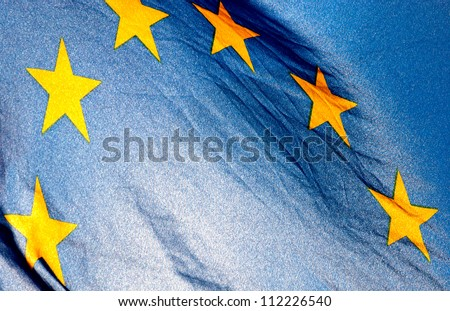 Fragment of the European Union Flag waving in in backlit sunlight - stock photo