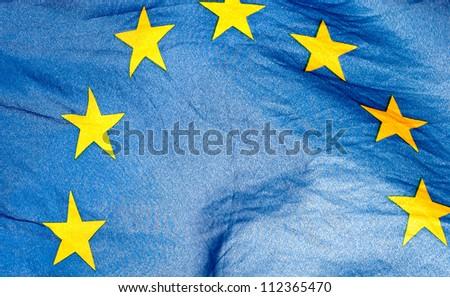 Fragment of the waving European Union Flag in sunshine - stock photo